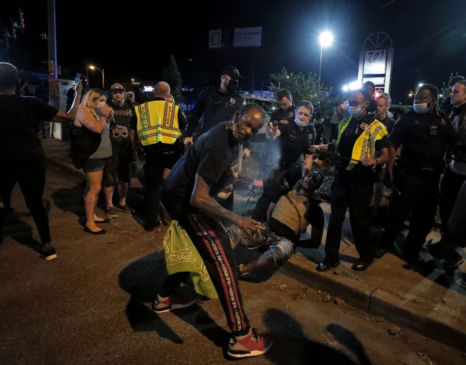 <strong>A man gets pepper-sprayed by police on May 27 during a small impromptu protest over the death of George Floyd. The protest escalated into a series of tense moments with police in Midtown Memphis. This would be the first of 12 straight days and nights of protests across the city.</strong> (Patrick Lantrip/Daily Memphian)