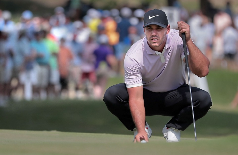<strong>Brooks Koepka (at the 2019 WGC-FedEx St. Jude Invitational) lines up a putt on the 17th green during the third round of tournament play at Southwind on July 27, 2019.</strong> (Jim Weber/Daily Memphian file)