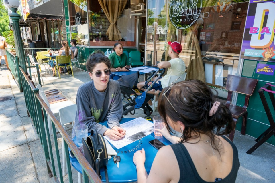 <strong>Anna Shull and Sarah Brumlede enjoy Sunday brunch on the patio at The Beauty Shop/DKDC on opening day.&nbsp;</strong>(Greg Campbell/Special to Daily Memphian)