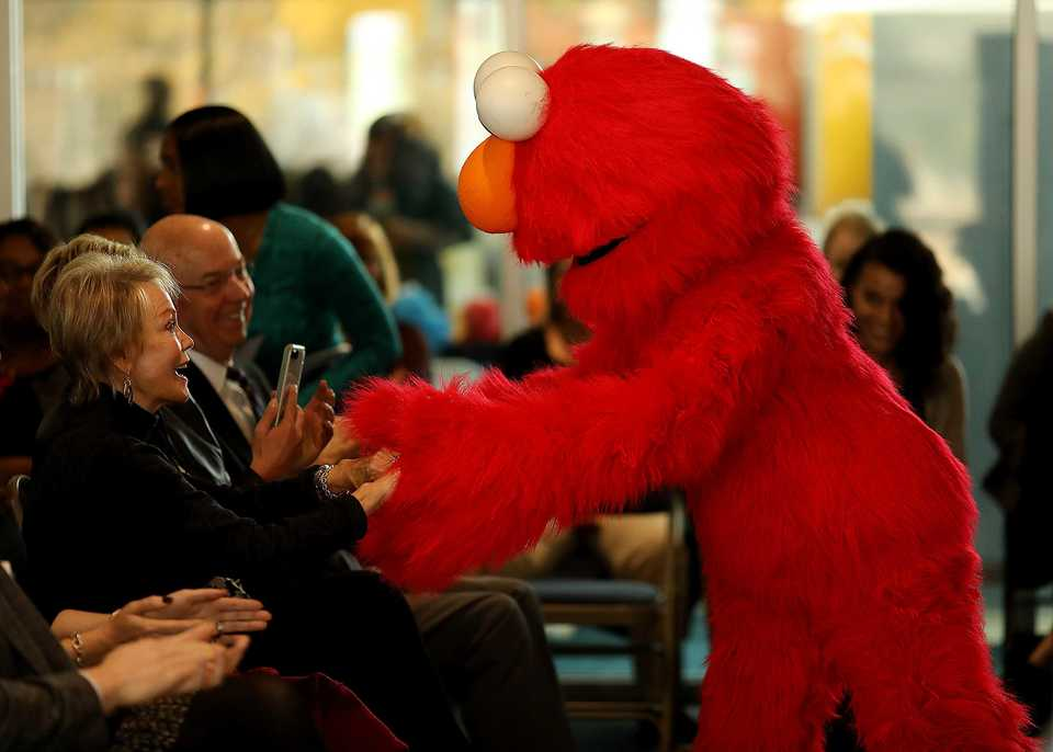 <strong>Elmo was in town Tuesday, Dec. 4, to kick off a collaboration between the Sesame Workshop, ACE Awareness Foundation and Porter-Leath that aims to provide more resources to local families in need.</strong> (Patrick Lantrip/Daily Memphian)