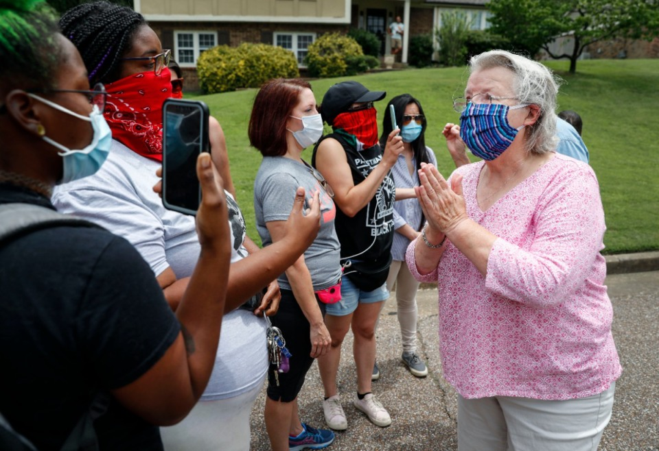 <strong>Protesters have a conversation with a neighbor, while protesting outside of the home of Lloyd Crawford on Monday, June 29, 2020, in Germantown.</strong> (Mark Weber/Daily Memphian)