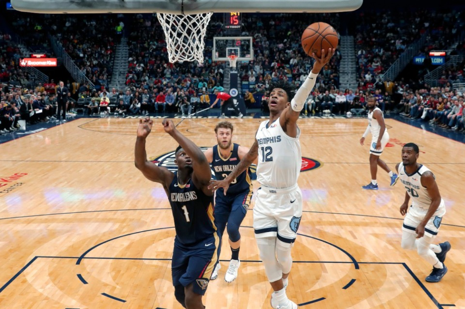 <strong>Memphis Grizzlies guard Ja Morant (12) goes to the basket against New Orleans Pelicans forward Zion Williamson (1) during the first half of an NBA basketball game in New Orleans, Friday, Jan. 31, 2020.</strong> (Gerald Herbert/AP file)