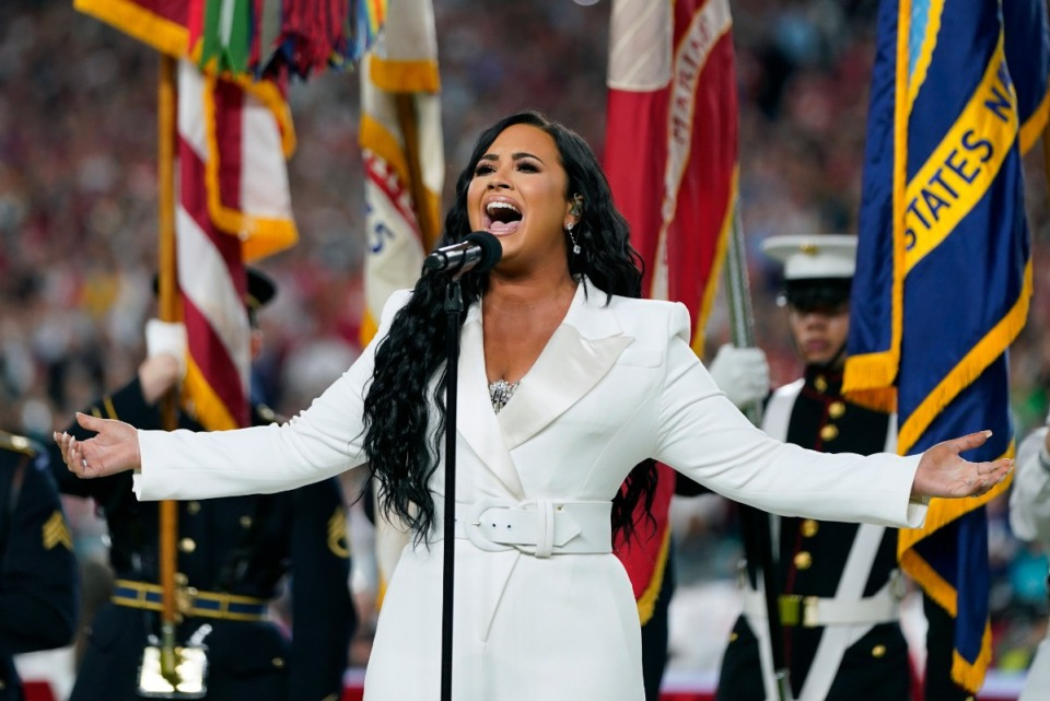 <strong>Demi Lovato sings the national anthem before the NFL Super Bowl 54 football game in Miami Gardens, Fla., on Feb. 2.</strong> (David J. Phillip/Associated Press file)