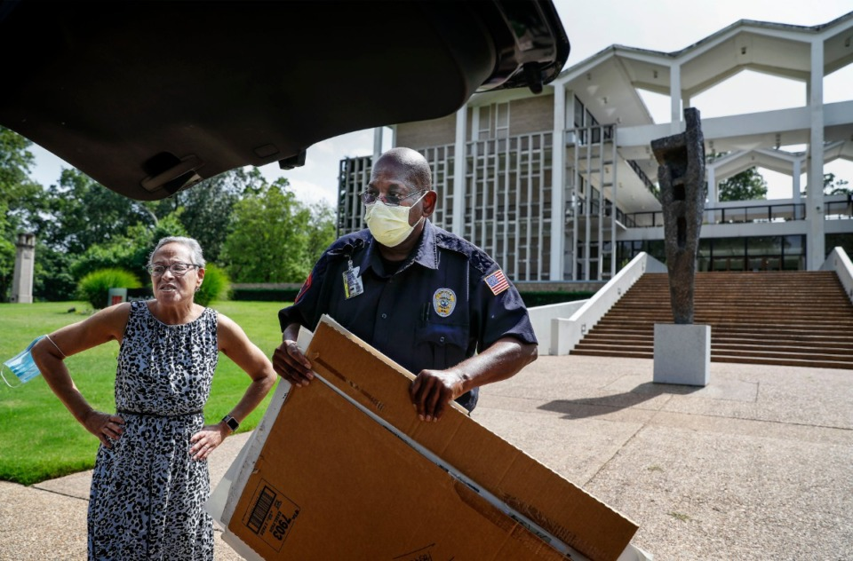 <strong>Memphis College of Art instructor Maritza Davila (left) gets help from campus security officer Alfred Flowers (right) loading 36 years' worth of former students' artwork into her car outside of Rust Hall on Tuesday, June, 30, 2020. On Tuesday, college administrators handed over the keys and vacated Rust Hall.</strong> (Mark Weber/Daily Memphian)
