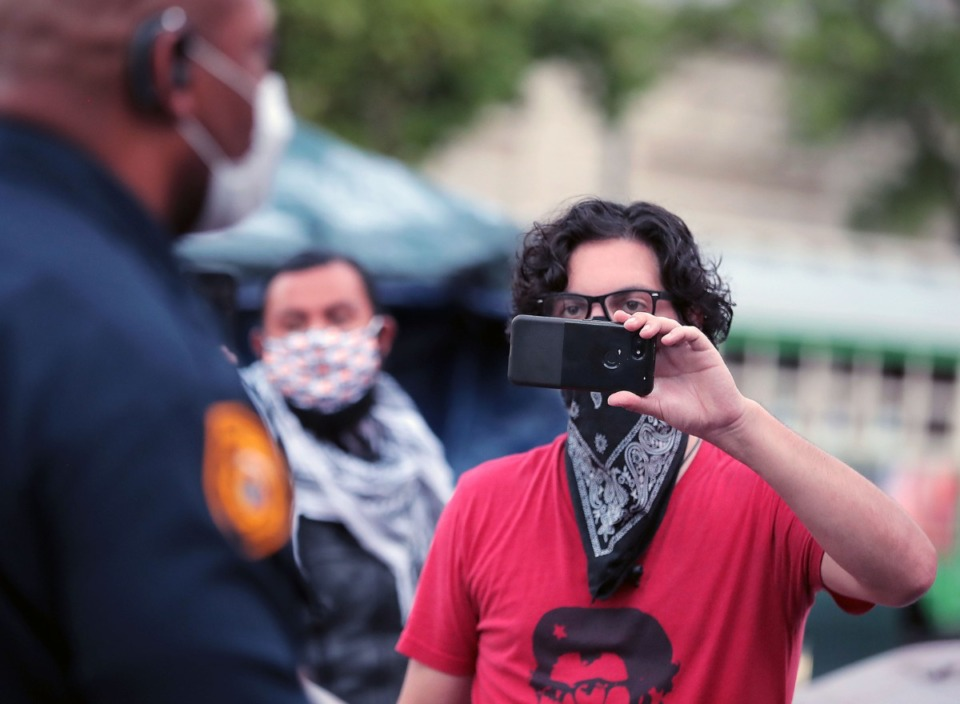 <strong>Matt Germany films a Memphis Police officer June 30, 2020 who told a group of protesters they needed to move their tents so the city can begin construction on City Hall.</strong> (Patrick Lantrip/Daily Memphian)