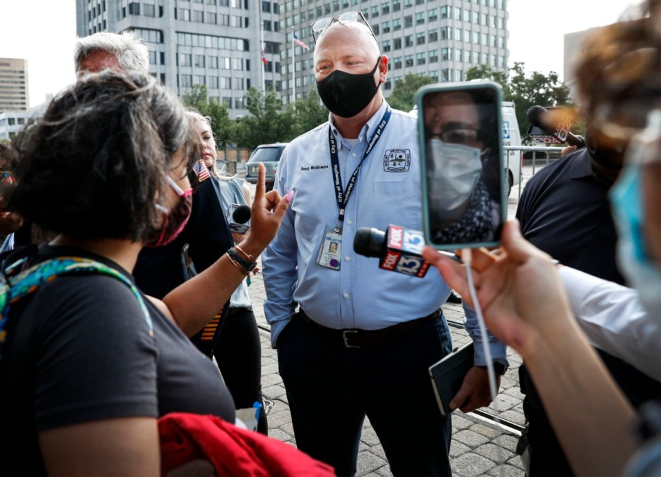 <strong>City of Memphis chief operating officer Doug McGowen (middle) speaks to activist before Memphis Police arrest a protester outside City Hall on Wednesday, July 1, 2020.</strong>(Mark Weber/Daily Memphian)