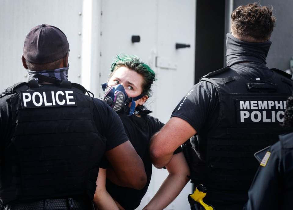 <strong>Police arrest a protester outside City Hall on Wednesday, July 1, 2020.</strong>(Mark Weber/Daily Memphian)