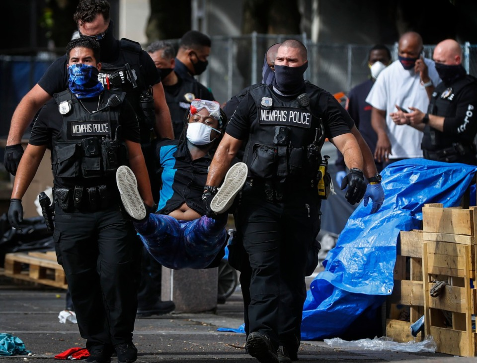 <strong>Memphis protester 'Salamander' is removed by Memphis Police outside City Hall on Wednesday, July 1, 2020.</strong> (Mark Weber/Daily Memphian)