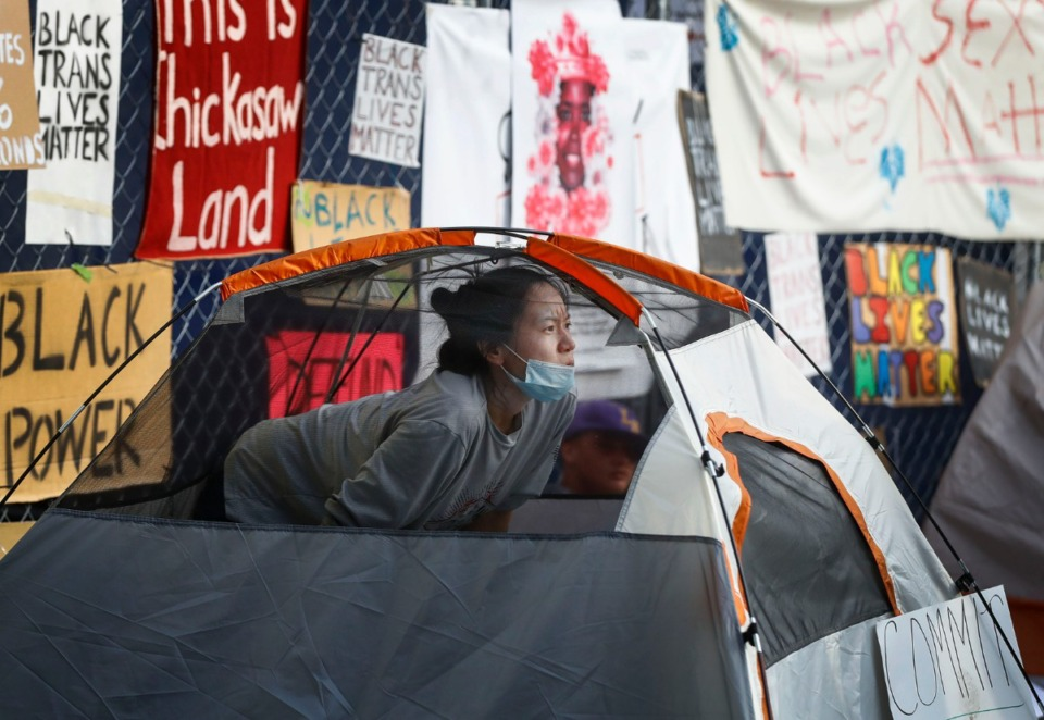 <strong>A protester sits inside a tent outside City Hall before being arrested by&nbsp; Wednesday, July 1, 2020.</strong> (Mark Weber/Daily Memphian)