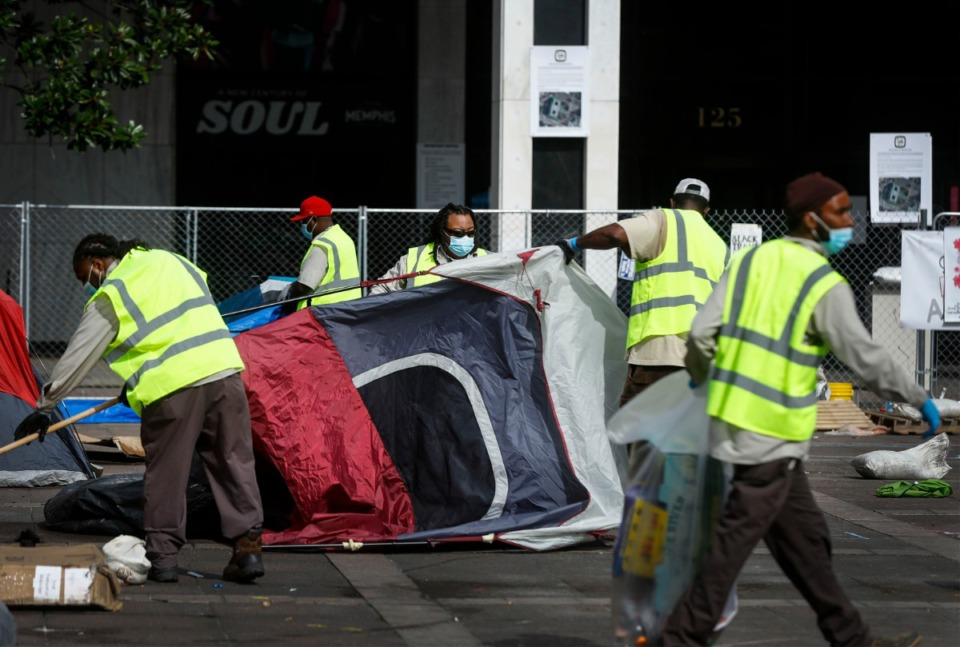 <strong>Memphis sanitation workers clean up tents outside City Hall after Police arrest protesters on Wednesday, July 1, 2020.</strong> (Mark Weber/Daily Memphian)