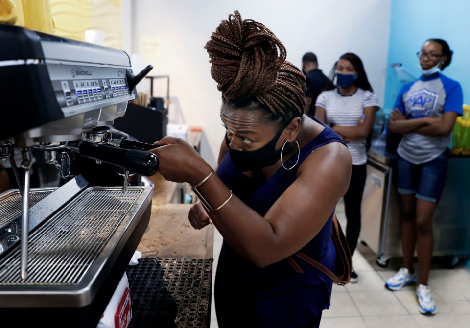<strong>Muggin&rsquo; Coffee House barista Kim Adams learns to use an espresso machine during training for new employees on Thursday, June 25, 2020. The Whitehaven coffee shop will feature gourmet coffee from local roasters and will also serve locally made scones, pastries, muffins and cupcakes.</strong> (Mark Weber/Daily Memphian)