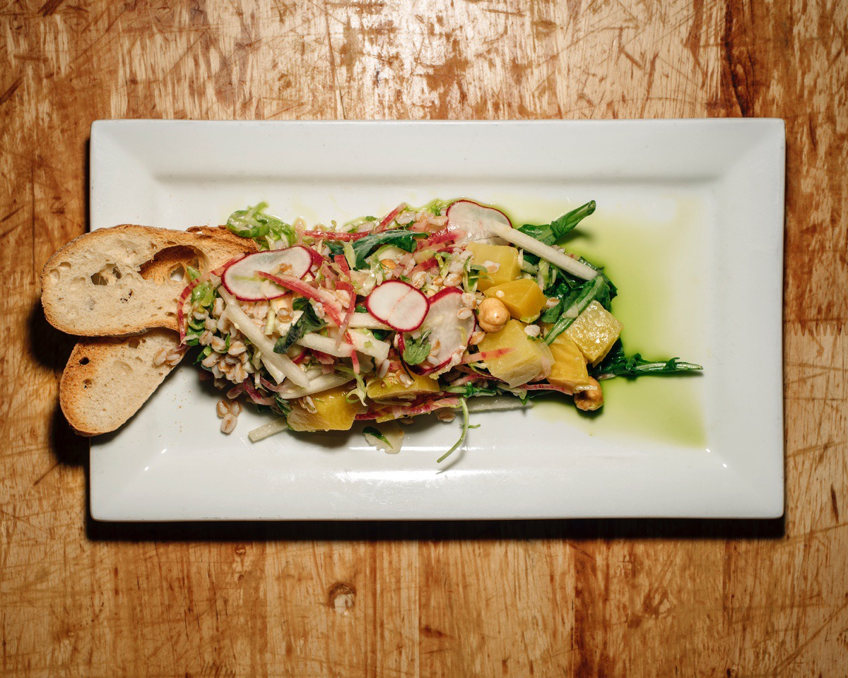 <strong>The farro golden beet salad is one of River Oak's more popular items on the menu. The dish includes chunks of golden beets, hazelnut, farro and watermelon-radish slices.</strong> (Houston Cofield/Special To The Daily Memphian)