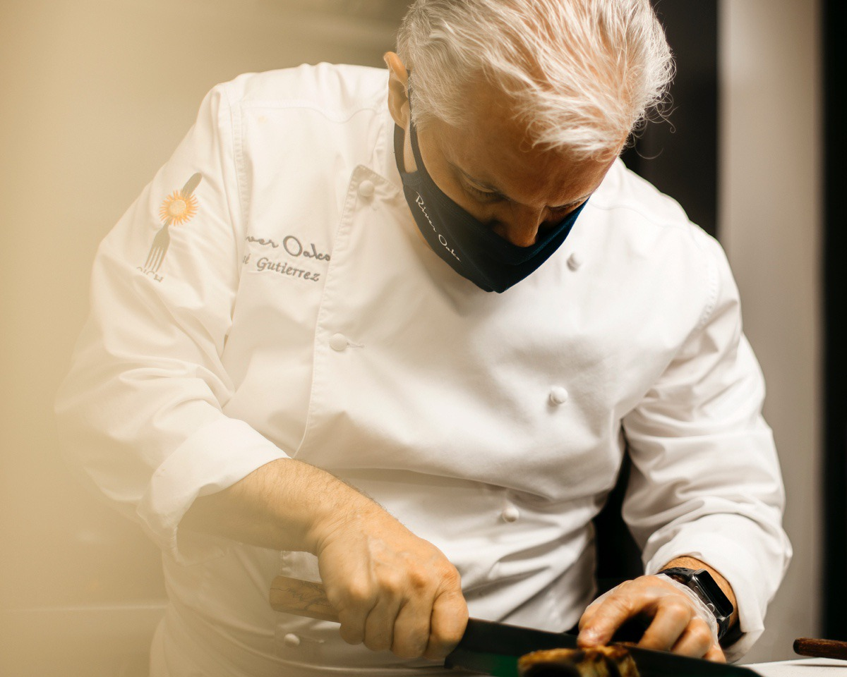 <strong>Jos&eacute; Gutierrez, master chef and owner of River Oaks restaurant, puts the finishing touches on a crispy tuna dish before it leaves the kitchen. </strong>(Houston Cofield/Special to The Daily Memphian)