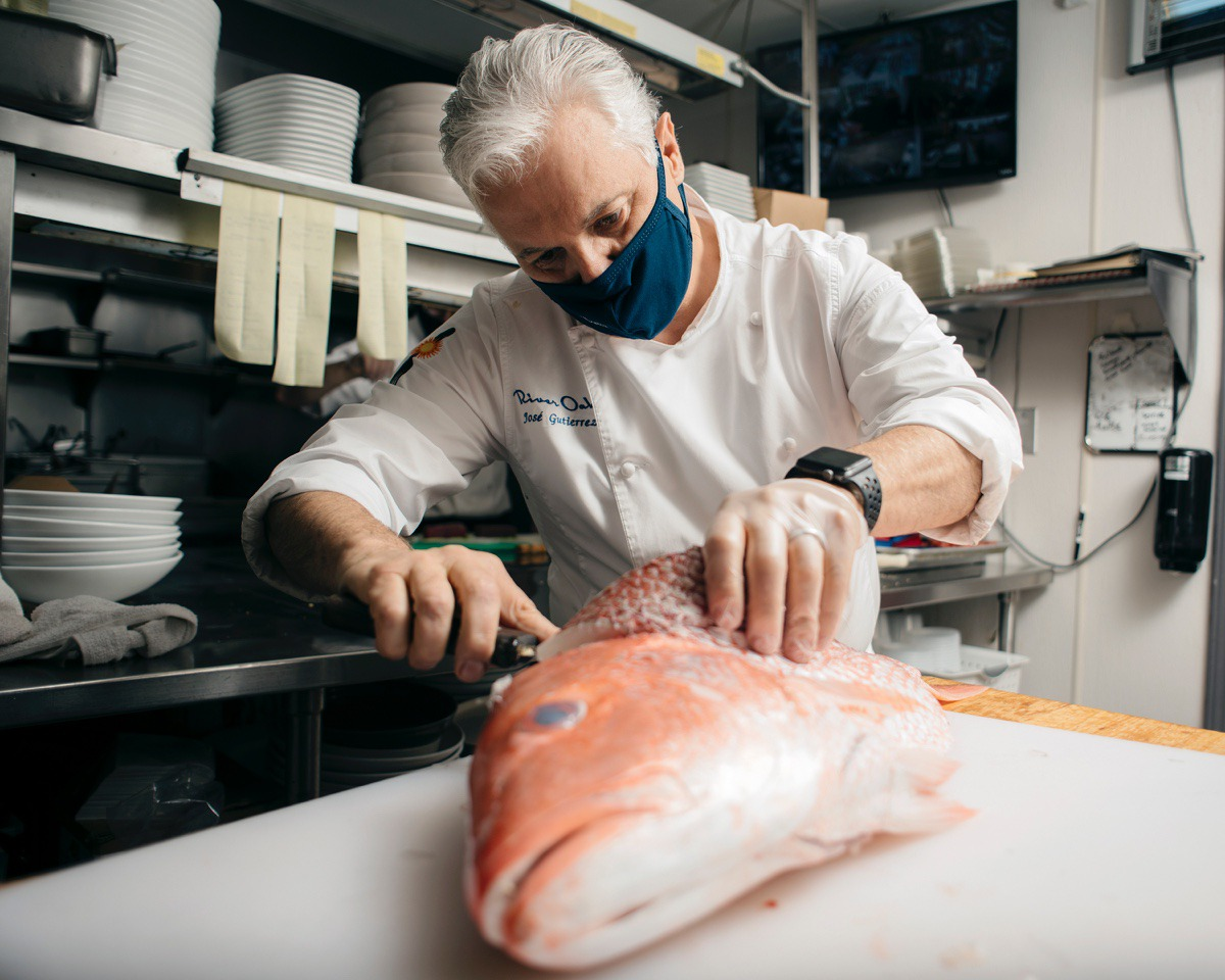 <strong>Jos&eacute; Gutierrez, master chef and owner of River Oaks restaurant, fillets a large red snapper as he prepares to put it on the grill. Gutierrez's restaurant is hosting dine-in seating and curbside pick up during the pandemic.</strong> (Houston Cofield/Special to The Daily Memphian)