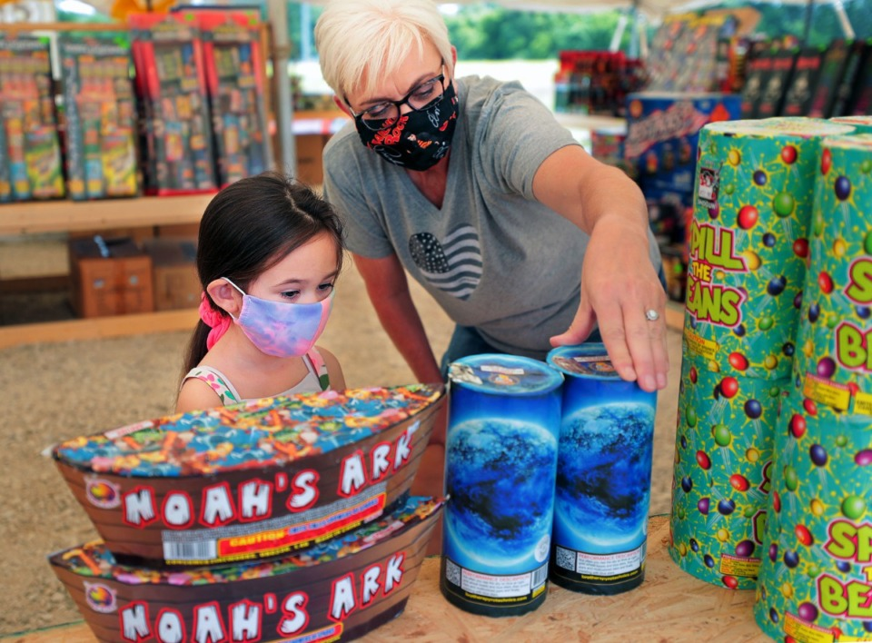 <strong>Barbra Ward helps her granddaughter Addie Ward pick out some fireworks for their Fourth of July celebrations at Crazy K Fireworks in Millington on Friday, July 3.&nbsp;Crazy K is one of several fireworks retailers set up in Millington this year.</strong>&nbsp;(Patrick Lantrip/Daily Memphian)