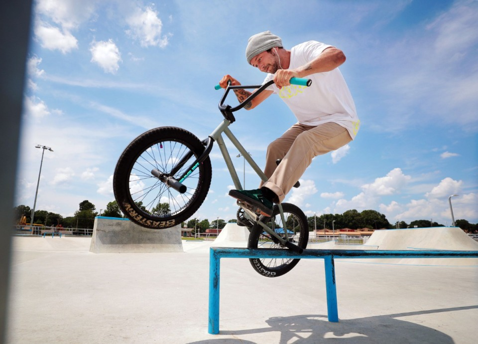 <strong>Mike Green grinds a rail during local artist David Yancy's Best Trick Contest at the Raleigh skatepark July 4, 2020.</strong> (Patrick Lantrip/Daily Memphian)