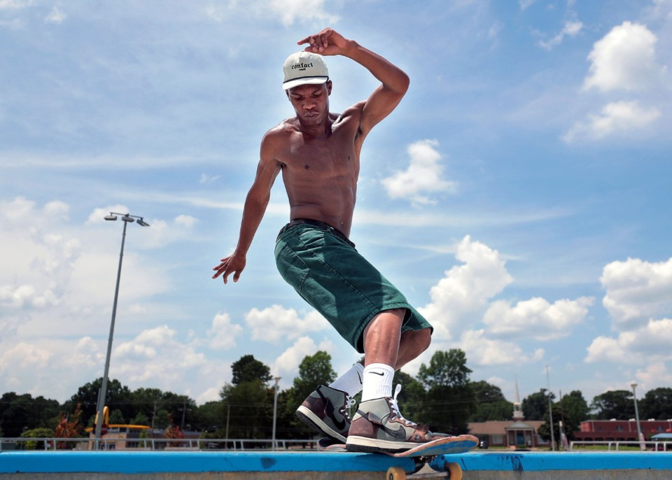 <strong>Asher Kelly sticks his landing during local artist David Yancy's Best Trick Contest at the Raleigh skatepark July 4, 2020.</strong> (Patrick Lantrip/Daily Memphian)