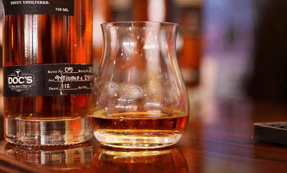 <strong>Doc's Wine, Spirits and More is currently selling its own house whiskey brand under the Doc.52 label.</strong> (Patrick Lantrip/Daily Memphian)
