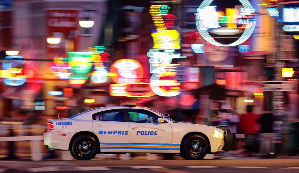 <strong>A Memphis Police cruiser passes Beale Street while on patrol on Second Street in Downtown Memphis on May 9, 2020.</strong> (Jim Weber/Daily Memphian)