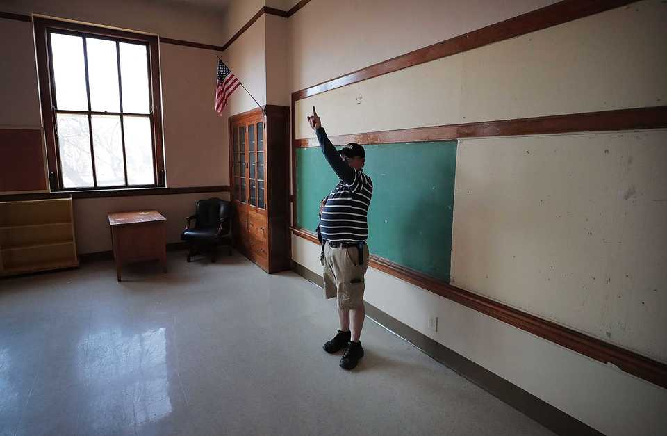 <strong>Facilities Manager David Cummings talks about some of the history of St. Anne Catholic School near the University of Memphis campus during a tour of the building on Dec. 5, 2018. Built in the 1940s, St. Anne Catholic School on Highland has been empty for a few years, but now the University of Memphis is looking to reopen the school so the university can establish a campus middle school.</strong> (Jim Weber/Daily Memphian)