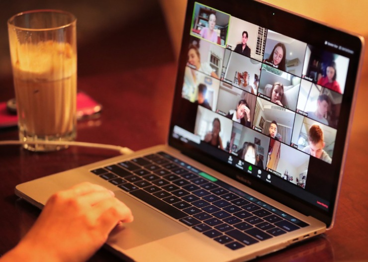 <strong>Sam Tronsor, who is enrolled at an international school in Hong Kong, connects with classmates at the start of a day of virtual schooling from his East Memphis home on March 18. Because of the time difference, Sam and his twin sister, Kate, attend class from 8 p.m. until 2 a.m., using video conference software to connect and work in small groups.</strong> (Daily Memphian file)