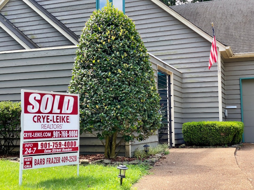 """<strong>The """"Sold"""" sign was erected in front of this Midtown home this week, just a couple of weeks after the """"For Sale"""" sign was posted. The number of homes for sale has been steadily dropping, creating a strong seller's market.</strong> (Tom Bailey/The Daily Memphian)"""