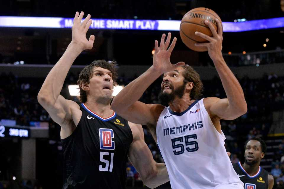 <span><strong>Memphis Grizzlies center Joakim Noah (55) drives against Los Angeles Clippers center Boban Marjanovic (51) in the second half of an NBA basketball game Wednesday, Dec. 5, 2018, in Memphis, Tenn.</strong> (AP Photo/Brandon Dill)</span>