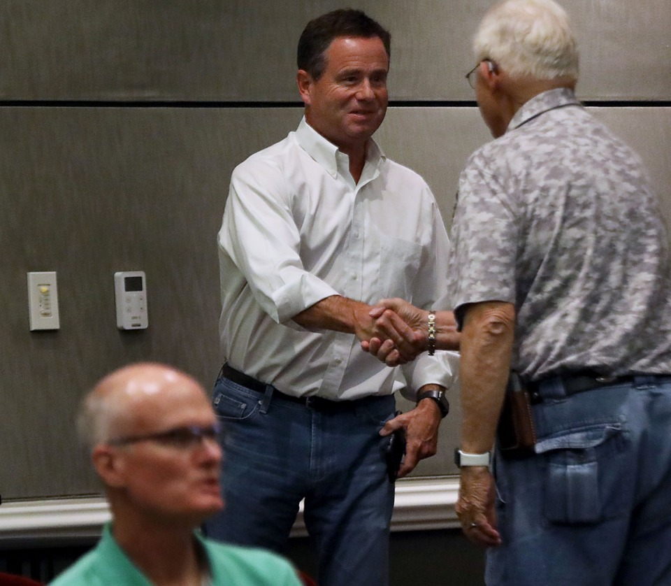 <strong>John Porter shakes hands with a Collierville resident as he leaves a Sept. 5, 2019, Collierville Planning Commission meeting where his residential proposal was shot down.</strong> (Patrick Lantrip/Daily Memphian file)