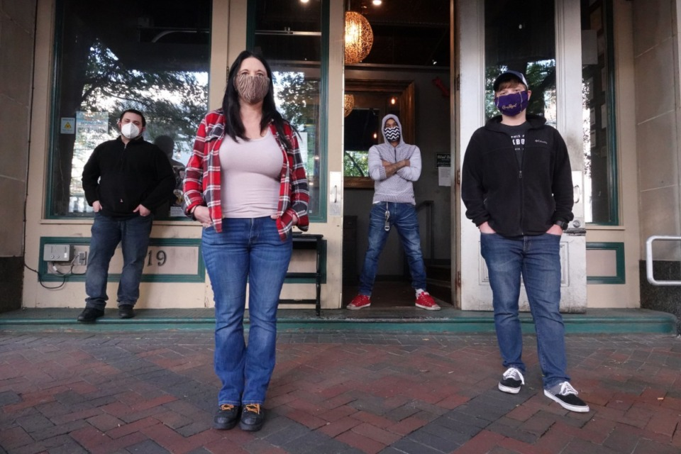 <strong>Blind Bear Speakeasy (the owner Jeannette Comans is shown with her employees outside her club in Downtown Memphis on April 19) is among a group of bars suing the Shelby County Health Department.</strong> (Karen Pulfer Focht/ Special to the Daily Memphian file)