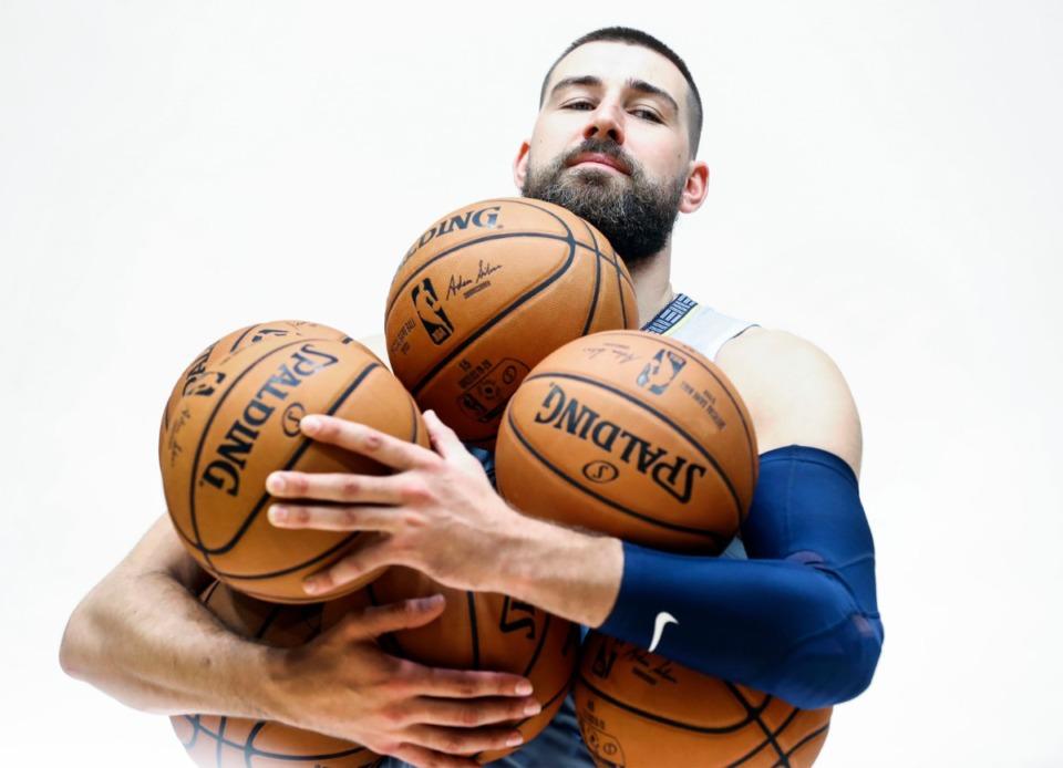 <strong>Jonas Valanciunas corrals several ball during a photo shoot at the Memphis Grizzlies media day Monday, Sept. 30, 2019.</strong> (Mark Weber/Daily Memphian)