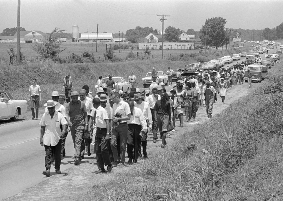 <strong>In this June 9, 1966, file photo, civil rights activists led by Dr. Martin Luther King Jr. stretch out along Highway 51 south near Senatobia, Miss., on a march to the capital, Jackson, started by James Meredith. The March Against Fear helped many find a voice to protest the injustices of the day.</strong> (AP file photo)