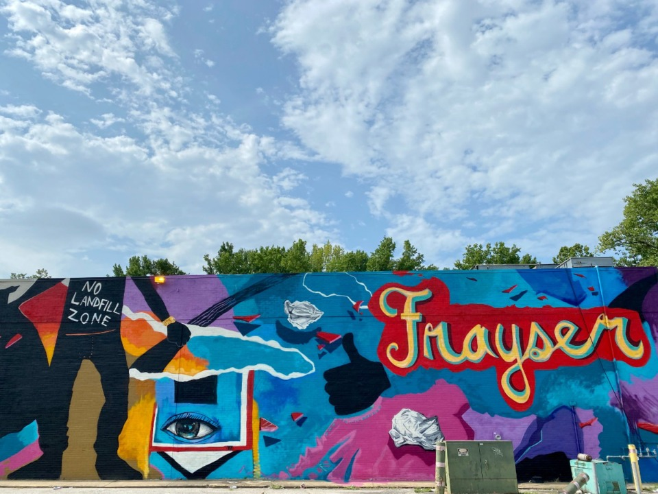 <strong>Memphis muralist Jamond Bullock (signing as Alive Paint) recently completed this mural on the side of the Superlo Foods building on North Watkins at Frayser Boulevard.</strong> (Tom Bailey/Daily Memphian)
