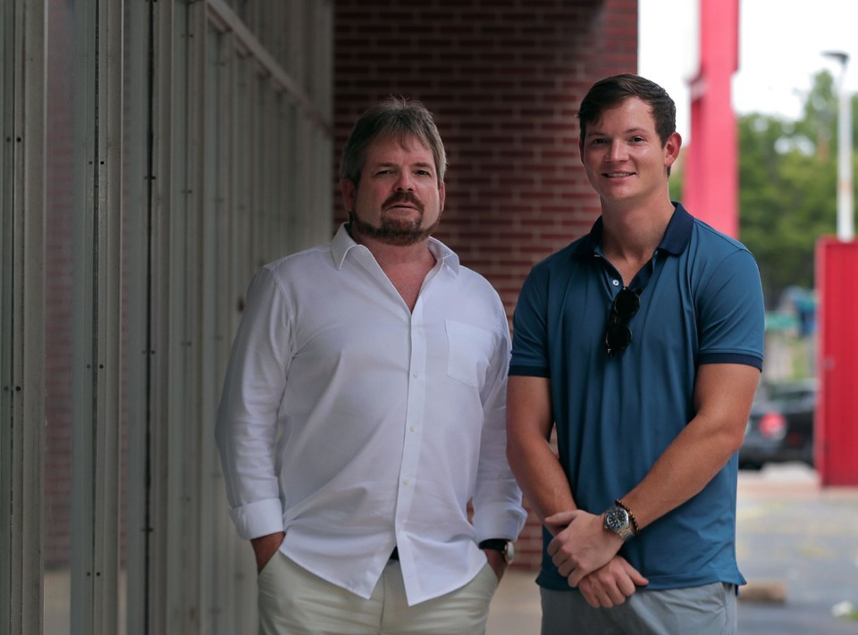 <strong>Frank Kemker (left) and Clayton Kemker stand in front of 193 Pine St., a vacant building they plan on remodeling into luxury apartments.</strong> (Patrick Lantrip/Daily Memphian)