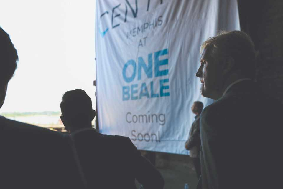 """<p class=""""p1""""><span class=""""s1""""><strong>Kevin Kane, president and CEO of Memphis Tourism, listens as Chance Carlisle of Carlisle Corp. announces in July 2018 his company's plans for the One Beale building.</strong> (Houston Cofield/Daily Memphian file)</span>"""