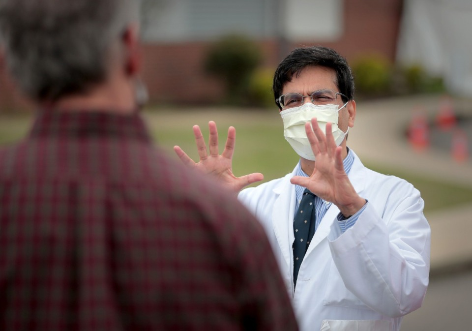 <strong>Infections Disease expert Manoj Jain (right, talking with Gov. Bill Lee during a visit to the Christ Community COVID-19 testing site in Frayser on April 25, 2020) warned readers of The Daily Memphian in February that life could be &lsquo;greatly disrupted&rsquo; by a coronavirus outbreak.&nbsp;</strong>(Jim Weber/Daily Memphian file)