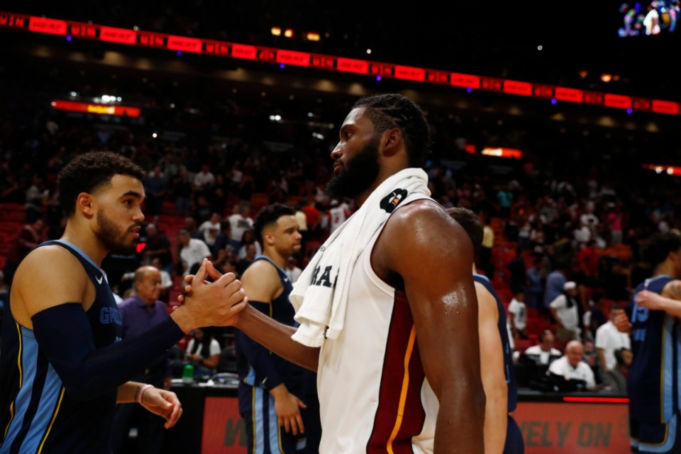 <strong>As a member of the Miami Heat, forward Justise Winslow (right) played against the Grizzlies in October&rsquo;s 2019-2020 season opener. Acquired by the team in February, he still hasn&rsquo;t played for them. Winslow&rsquo;s debut was delayed again after an injury at the NBA&rsquo;s Orlando campus.</strong> (AP Photo/Brynn Anderson)