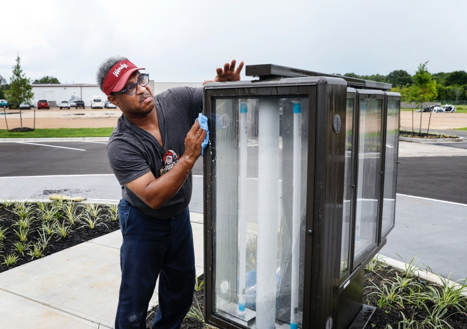 <strong>Wendy&rsquo;s employee&nbsp;Marl Bush cleans the drive-thru menu stand on Tuesday, July 21, 2020, on Airline Road. Working fast food has never been easy, but the pandemic has added a lot of extra complications.</strong> (Mark Weber/Daily Memphian)