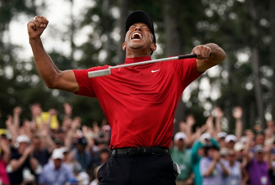 <strong>Tiger Woods reacts as he wins the Masters golf tournament April 14, 2019, in Augusta, Ga.</strong> (David J. Phillip/AP file)