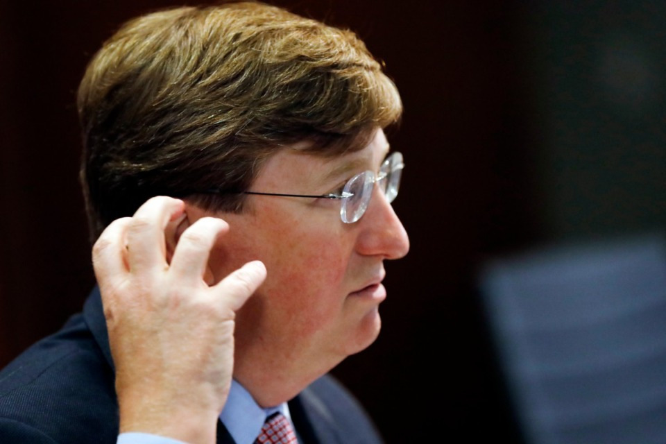 <strong>Mississippi Gov. Tate Reeves expresses his concern over the improper way some people wear their face masks as he speaks of the growing number of people testing positive with coronavirus statewide during a press briefing on July 20 in Jackson.</strong> (Rogelio V. Solis/Associated Press file)