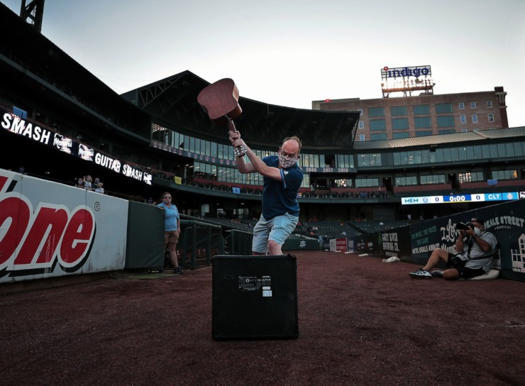 <strong>Dr. Jon McCullers performed the ceremonial guitar smash July 25, 2020, at the first Memphis 901 FC home game since the COVID-19 pandemic began.</strong> (Patrick Lantrip/Daily Memphian)