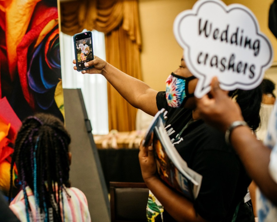 <strong>Guests of the Memphis Bridal Show take a selfie showing off the items they picked up during the expo. The bridal show moved ahead with its annual event despite the pandemic.</strong> (Houston Cofield/Special to Daily Memphian)