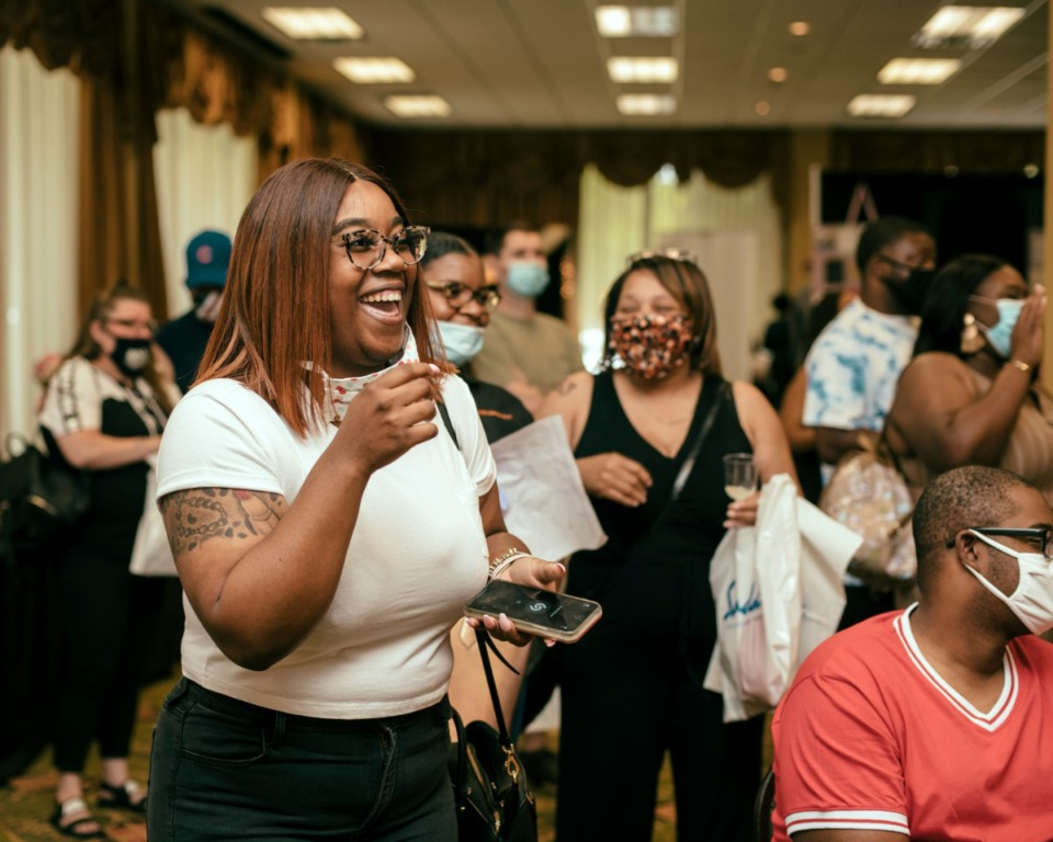 <strong>Chelsea Allison (left) laughs as her friend struggles to answer a trvia question at the Memphis Bridal Show. The bridal show hosted their annual event at the Whispering Woods Hotel in Olive Branch, Mississippi.</strong> (Houston Cofield/Special to Daily Memphian)