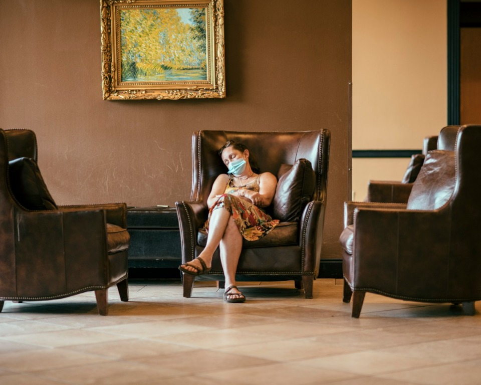 <strong>A tired bride waits for her friends in the lobby of the Whispering Woods Hotel after attending the Memphis Bridal Show.The bridal show moved ahead with its annual event despite the pandemic.</strong> (Houston Cofield/Special To Daily Memphian)