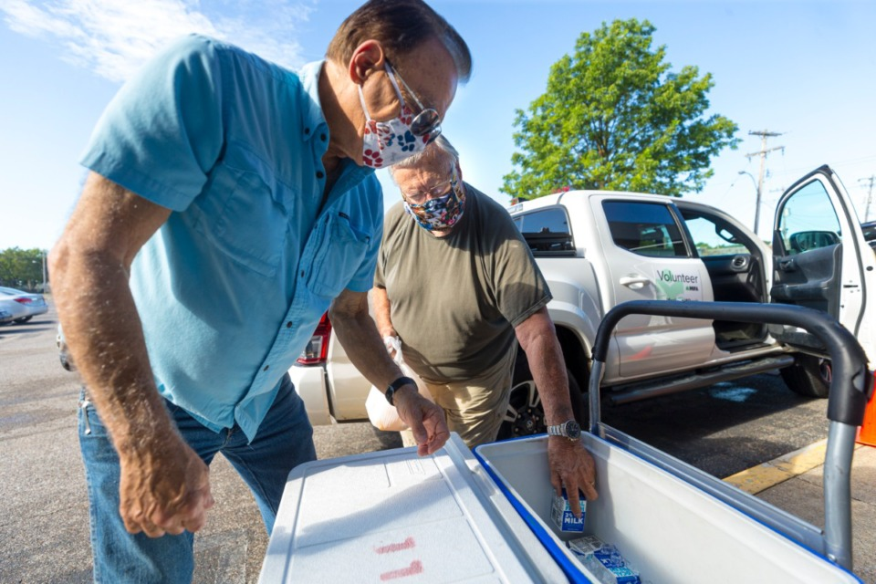 <strong>Trinity Christian Church volunteers Buddy Echols (left) and Tim Ackers pick up meals to distribute to communites at MIFA in Downtown Memphis on July 27, 2020.</strong> (Ziggy Mack/Special to The Daily Memphian)
