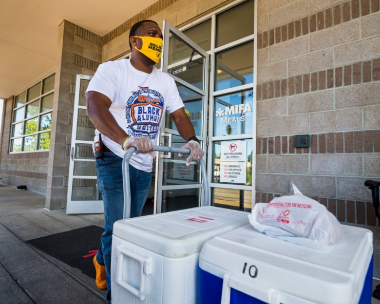 <strong>MIFA employee Craig Woods transports Meals on Wheels commodities in Downtown Memphis on July 27, 2020.</strong> (Ziggy Mack/Special to The Daily Memphian)