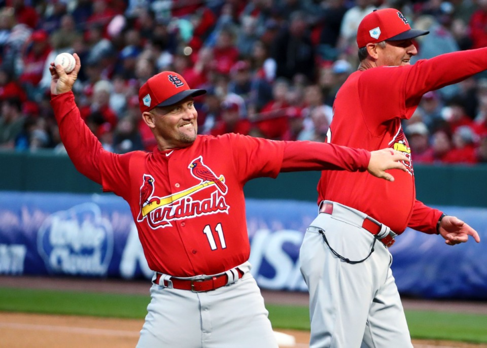 """<strong>St. Louis Cardinals first base coach Richard Keith """"Stubby"""" Clapp throws the opening pitch to the Battle of the Birds game on Monday, Mar. 25, 2019, at AutoZone Park.</strong> (Houston Cofield/Daily Memphian)"""