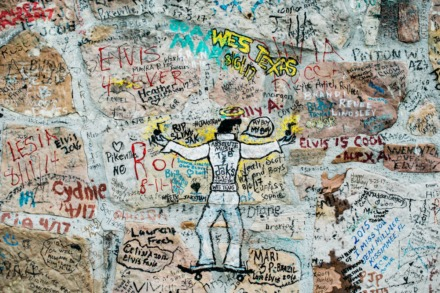 <strong>Visitors to Graceland sign, share memories, and show their respect for Elvis on the wall surrounding his home.</strong> (Daily Memphian file)