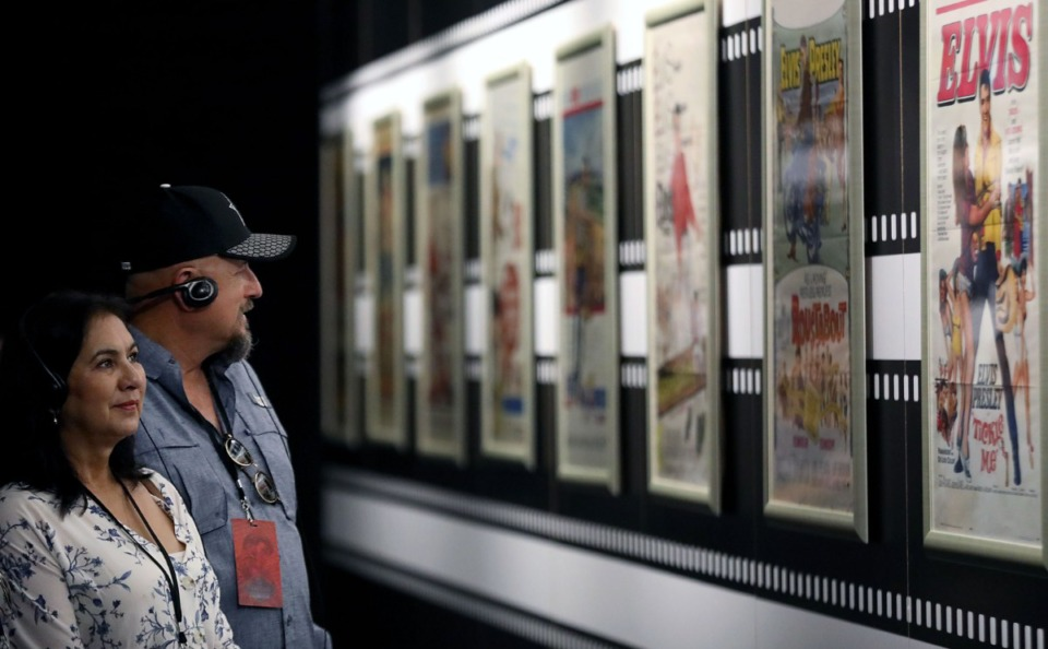 <strong>Sylvia and Reuben Martinez from Texas check out a wall of old movie posters at Elvis Presley's Memphis July 12, 2019.</strong> (Patrick Lantrip/Daily Memphian file)