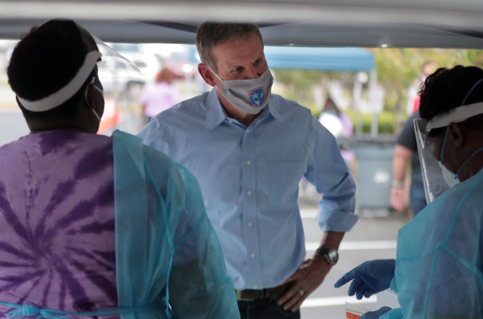 <strong>Tennessee Gov. Bill Lee talks to health care workers at a COVID-19 test site at Mississippi Boulevard Christian Church in Memphis June 19, 2020.</strong> (Patrick Lantrip/Daily Memphian)