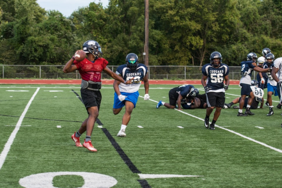 <strong>In this file photo, students run plays during football practice at Kirby High School.</strong> (Johnathan Martin/Daily Memphian file)